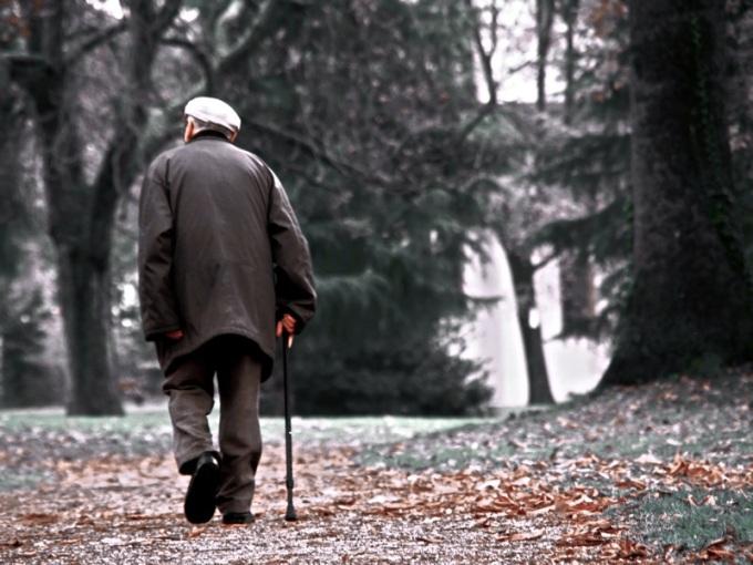 A man walking alone down a park path